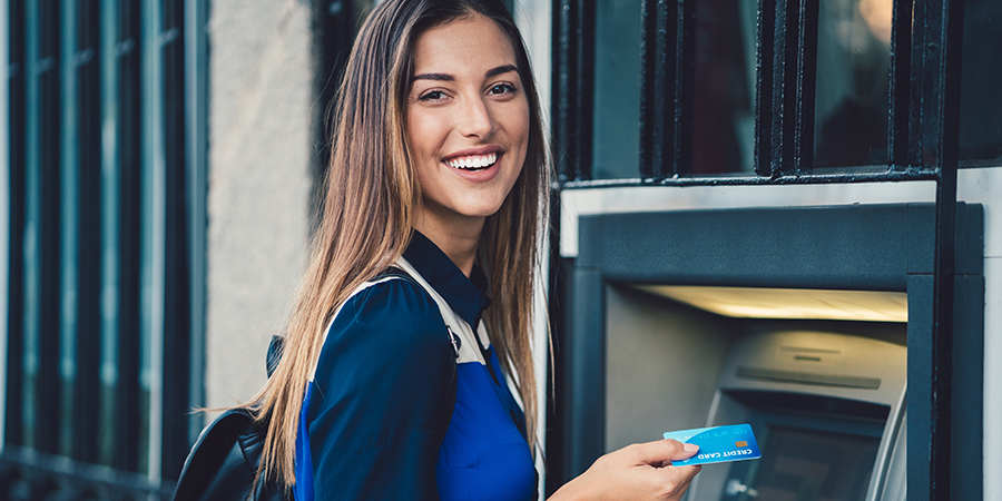 happy woman using ATM