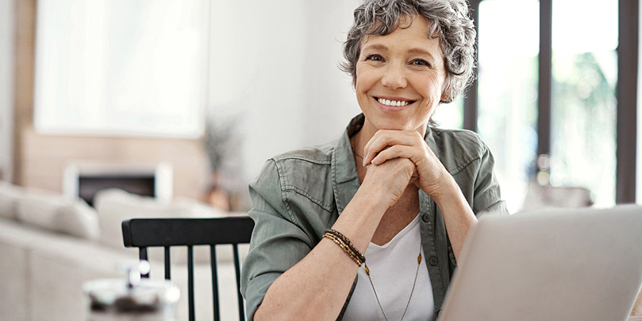 happy woman using website on laptop